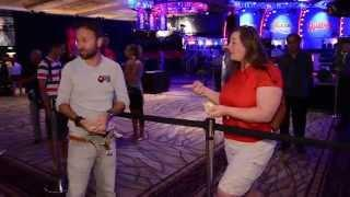 Daniel Negreanu pays up on a healthy bet at the 2014 World Series of Poker